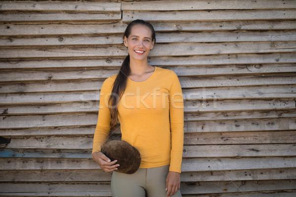 Feliz jovem jóquei em pé parede retrato Foto stock © wavebreak_media