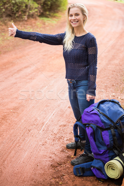 Pretty hitchhiker sticking thumb out Stock photo © wavebreak_media