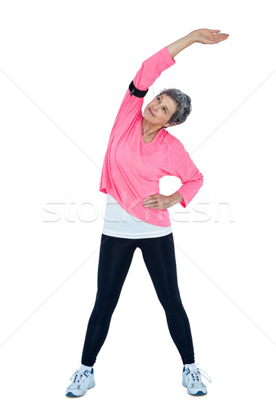 Mature woman stretching while listening music Stock photo © wavebreak_media