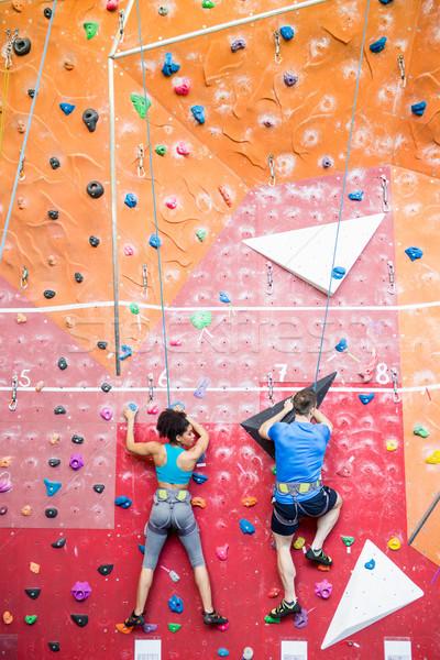 Fit couple rock climbing indoors  Stock photo © wavebreak_media