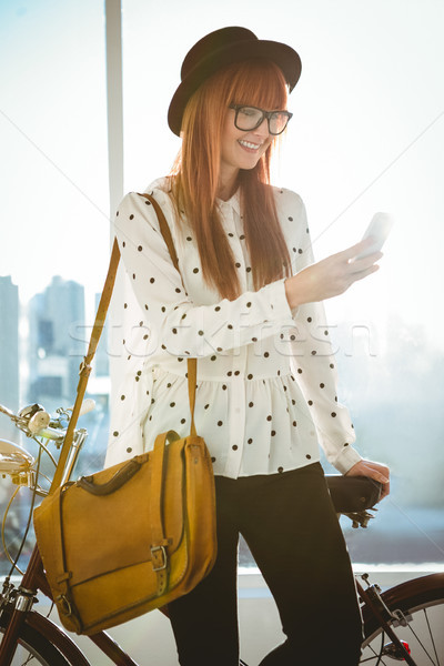 Smiling hipster woman taking selfie Stock photo © wavebreak_media