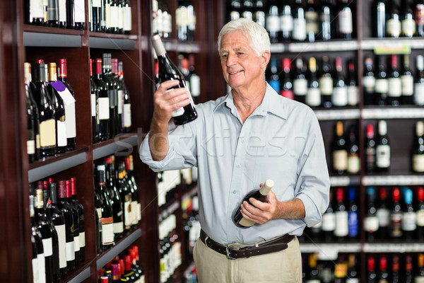 Smiling senior man choosing wine Stock photo © wavebreak_media