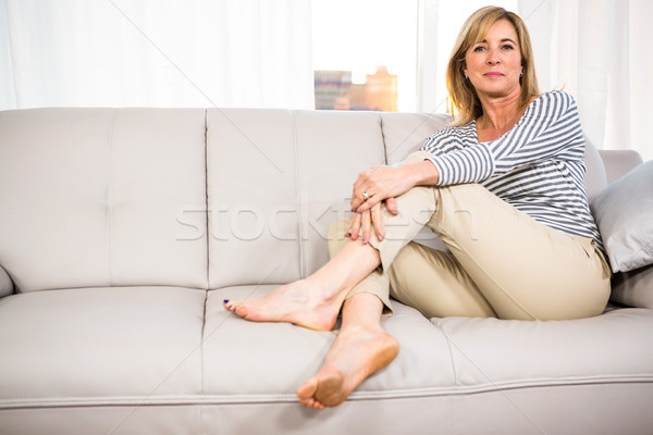 Woman relaxing on the sofa Stock photo © wavebreak_media