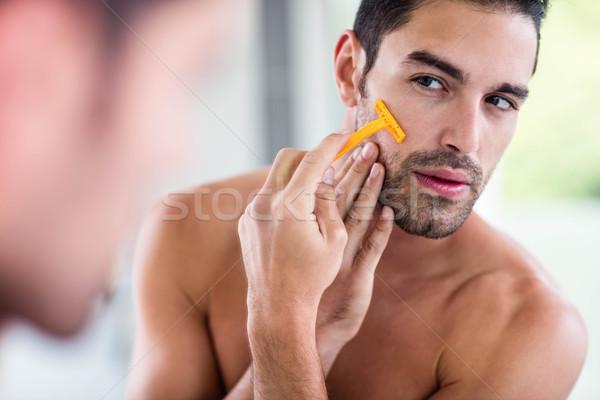 Jóképű férfi tükör fürdőszoba férfi otthon technológia Stock fotó © wavebreak_media