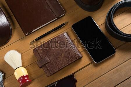 Various accessories arranged on wooden plank Stock photo © wavebreak_media