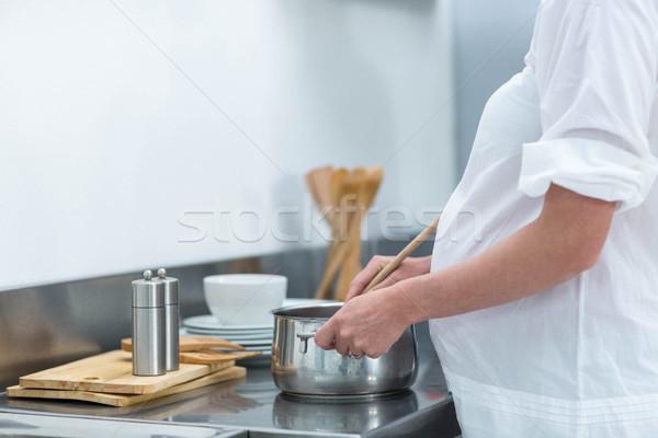 Pregnant woman busy in kitchen Stock photo © wavebreak_media