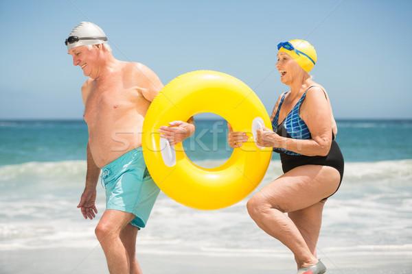 Starszy para pływanie pierścień plaży człowiek Zdjęcia stock © wavebreak_media