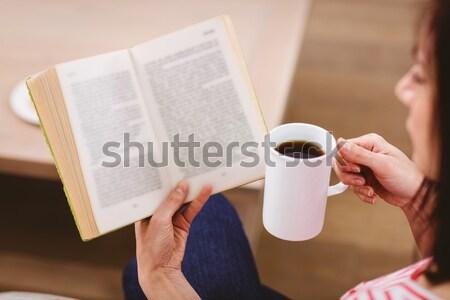 Hipster man reading while drinking coffee Stock photo © wavebreak_media