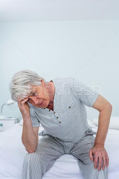 Senior homem sofrimento dor de cabeça sessão casa Foto stock © wavebreak_media