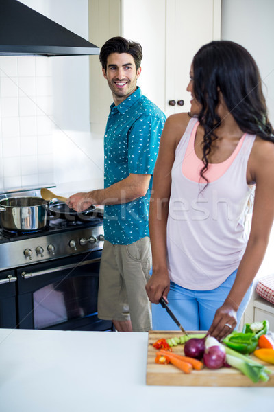 Young couple cooking food together in kitchen Stock photo © wavebreak_media