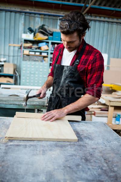 Carpinteiro trabalhando homem trabalhador estúdio ferramenta Foto stock © wavebreak_media