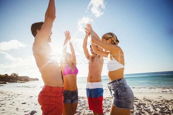 Barátok tánc tengerpart napos idő nő férfi Stock fotó © wavebreak_media