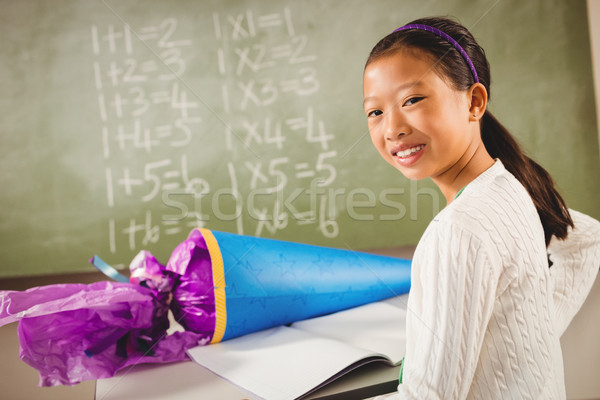 Smiling girl with a candy cone Stock photo © wavebreak_media