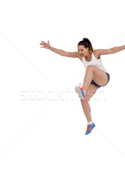 Athletic woman running on white background Stock photo © wavebreak_media