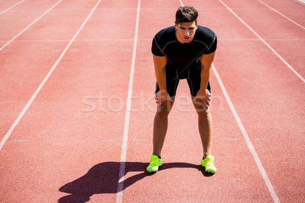 Tired athlete standing on running track Stock photo © wavebreak_media