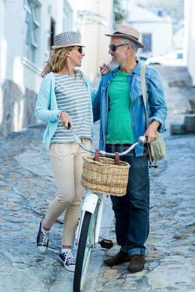 Stock photo: Mature couple with bicycle on street