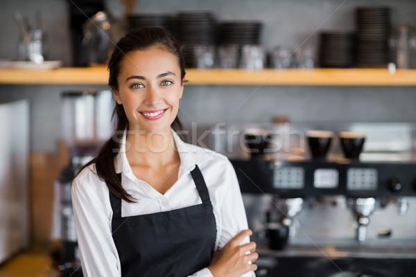 Portrait of smiling waitress standing with arms crossed Stock photo © wavebreak_media