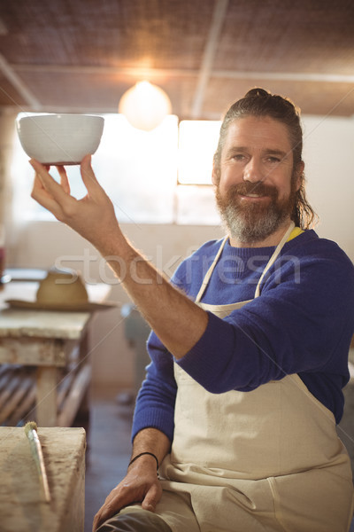 Potter holding bowl in workshop Stock photo © wavebreak_media
