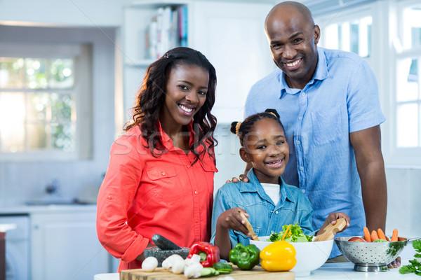 Happy family preparing food Stock photo © wavebreak_media