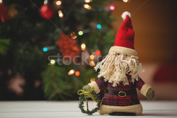 Święty mikołaj drewniany stół christmas czasu domu Zdjęcia stock © wavebreak_media