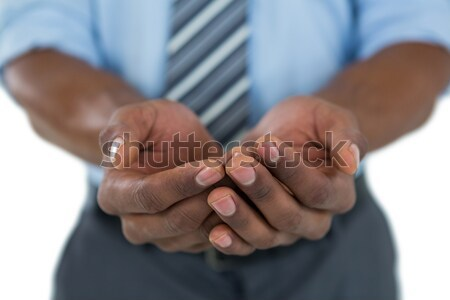 Cupped hands of man pretending to hold an invisible object Stock photo © wavebreak_media