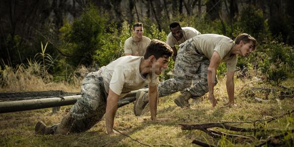 Soldados neto arranque campamento Foto stock © wavebreak_media