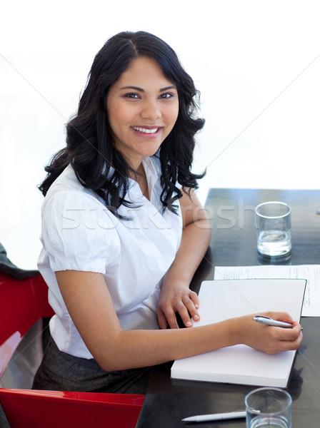 女性実業家 メモを取る 会議 笑みを浮かべて オフィス 紙 ストックフォト © wavebreak_media