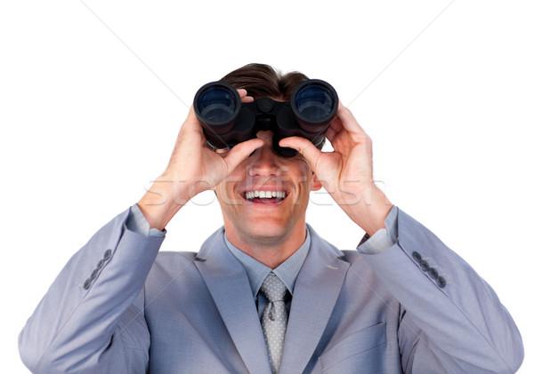 Enthusiastic businessman looking through binoculars  Stock photo © wavebreak_media