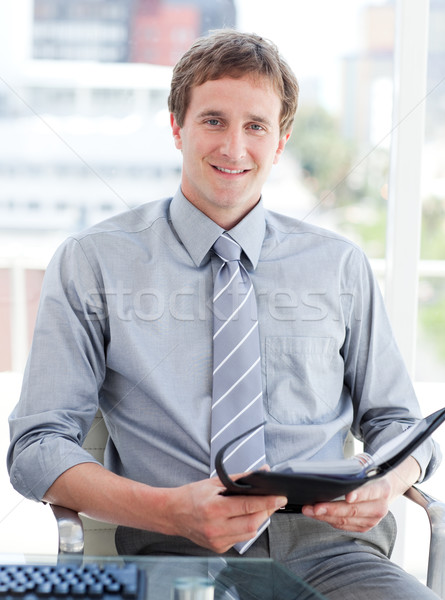 Young male executive looking at his agenda Stock photo © wavebreak_media