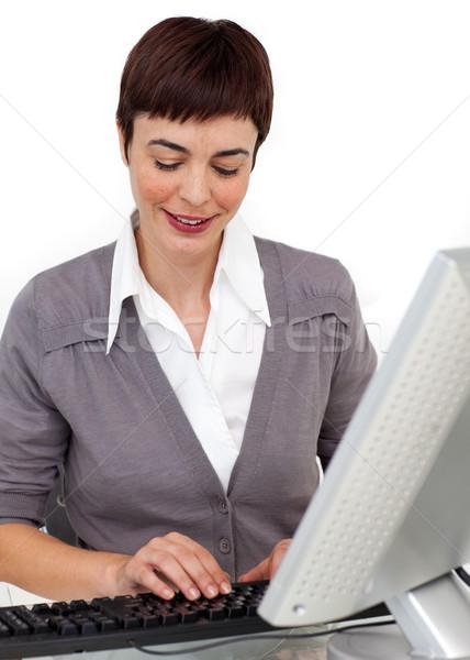 концентрированный деловая женщина рабочих компьютер белый бизнеса Сток-фото © wavebreak_media