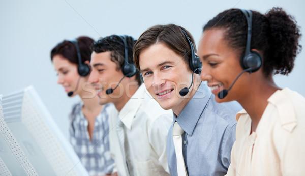 Atendimento ao cliente fone call center computador feliz microfone Foto stock © wavebreak_media