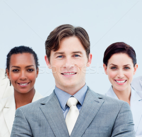 Smiling business people standing with folded arms  Stock photo © wavebreak_media