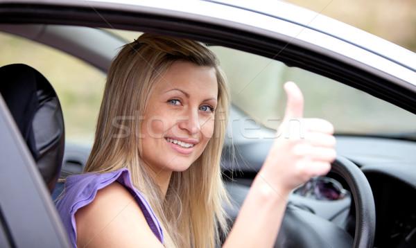 Smiling female driver with thumb up  Stock photo © wavebreak_media