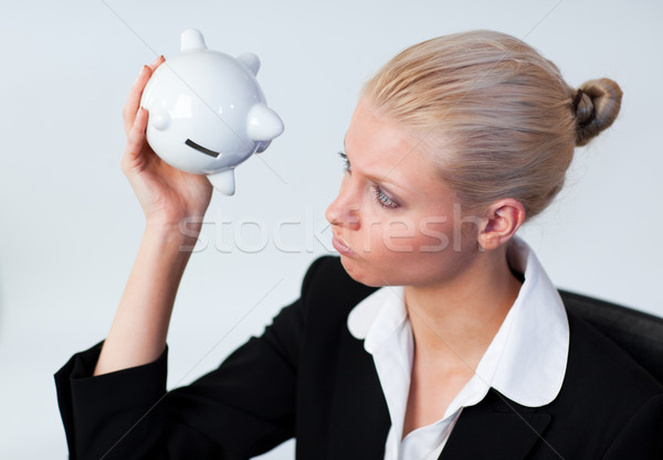 Sad Business woman looking into Piggy Bank Stock photo © wavebreak_media