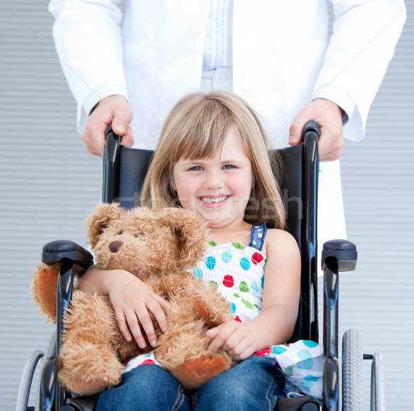 Portrait of a little girl sitting on the wheelchair supported by Stock photo © wavebreak_media