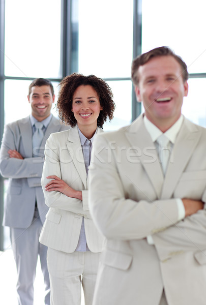 Smiling businesswoman with folded arms in a line Stock photo © wavebreak_media