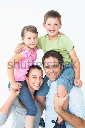 Parents giving children piggyback rides Stock photo © wavebreak_media