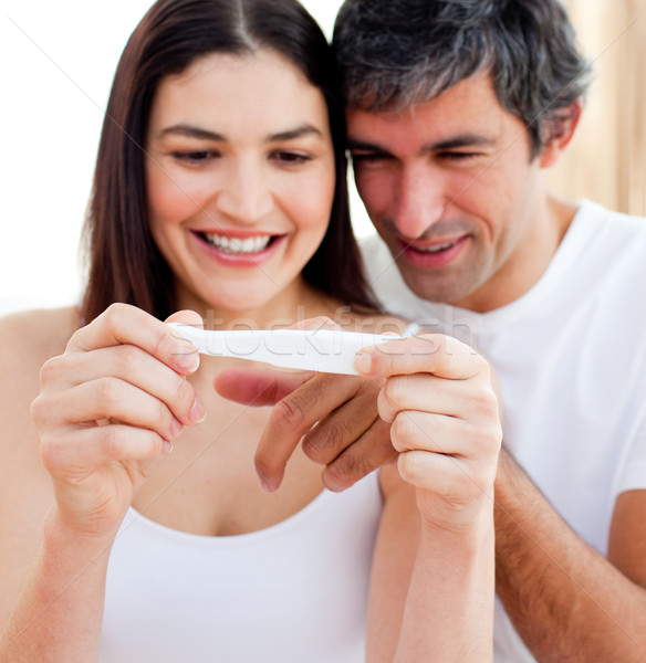 Blissful couple finding out results of a pregnancy test in th bedroom Stock photo © wavebreak_media
