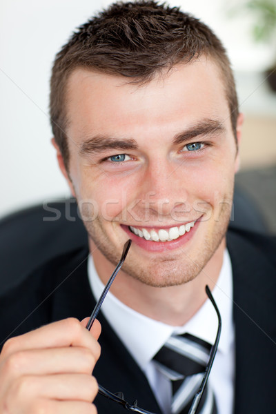 Good-looking businessman with glasses in his office Stock photo © wavebreak_media