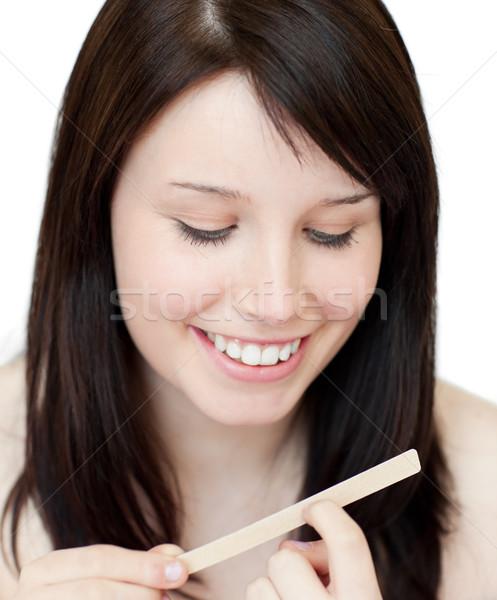 Portrait of a beautiful woman filing her nails Stock photo © wavebreak_media