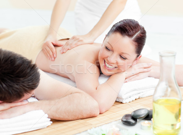 Glowing young couple receiving a back massage in a spa center Stock photo © wavebreak_media