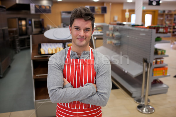 Assertive cook smiling at the camera in front of his bakery Stock photo © wavebreak_media