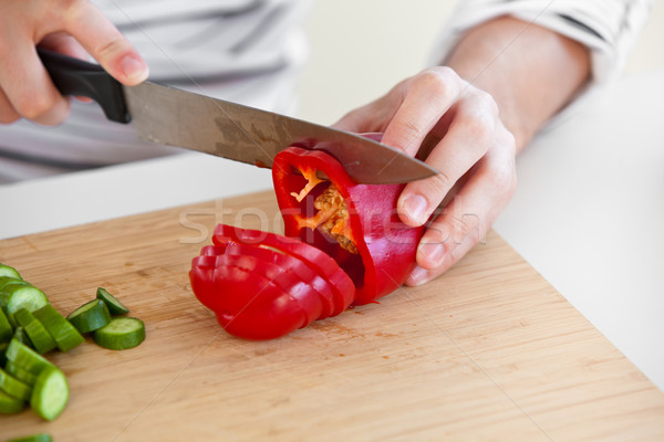 close-up of a man cutting red pepper standing in the kitchen Stock photo © wavebreak_media