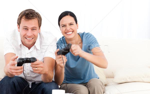 возбужденный женщину играет Видеоигры дружок диван Сток-фото © wavebreak_media