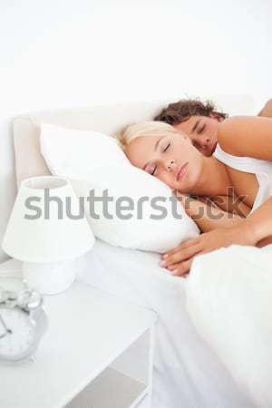 Paisible homme lit up chambre maison Photo stock © wavebreak_media