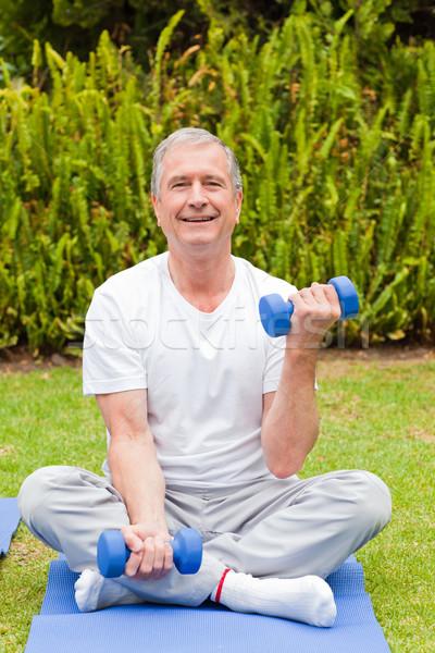 Retired man doing his exercises in the garden Stock photo © wavebreak_media
