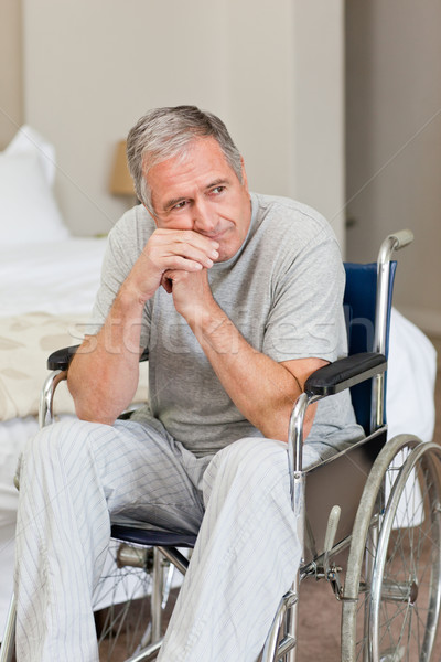 Glimlachend senior man rolstoel home medische Stockfoto © wavebreak_media