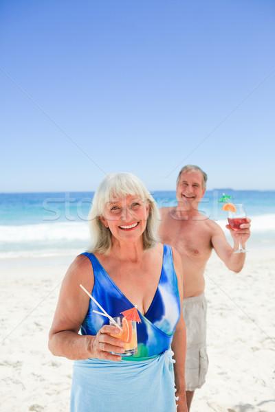 Radiant couple on the beach Stock photo © wavebreak_media