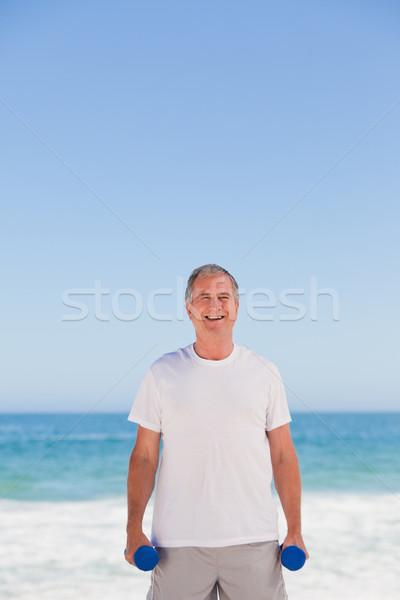 Elderly man doing his exercises Stock photo © wavebreak_media