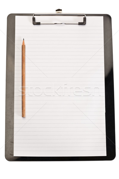 Pencil on the left of note pad on a white background Stock photo © wavebreak_media